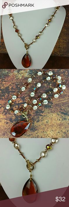"""Custom Design Amber Teardrop Beaded Necklace Stunning Custom Designed Amber Bead Necklace with Amber Teardrop Pendant I designed this using amber faceted AB beads and cream coin pearls.  For a modern touch, I put the gold tone toggle clasp in the front.  The acrylic amber tear drop is just gorgeous.  It is nearly 2"""" tall, 1 1/8"""" wide, and 1/2"""" thick.  Such a beautiful addition to your jewelry wardrobe.  Length:  14"""" ** Smoke free home ** Ships quickly Lady Revival Studio Jewelry Necklaces"""