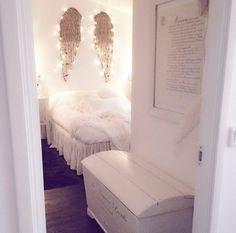 Angel wings above all white bed