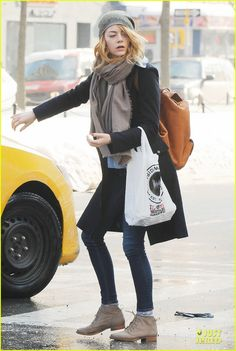 Emma Stone keeps it trendy while hailing a cab with two gal pals on Friday (February 14) in New York City.