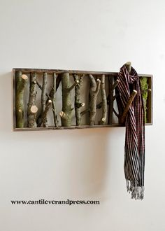 coat/tie/scarf rack made from tree branches.