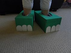 """Check out this FUN dinosaur craft idea!  We painted two tissue boxes green, let them dry, then cut out """"toenails"""" from sparkly sticky foam and stuck them on the front of the feet.  Butterfly STOMPED in her dinosaur feet roaring around the house!"""