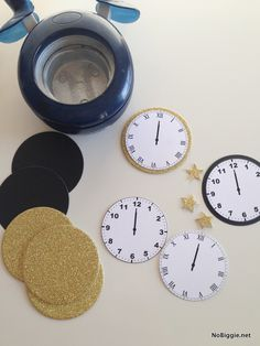 Celebrate New Year's Eve with this free print - midnight clocks - via NoBiggie.net