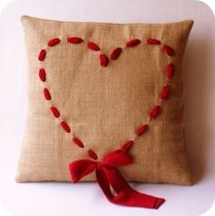 Gorgeous heart pillow... I feel like I could make this. But I might be overestimating my DIY skills.