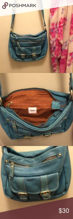 Turquoise leather cross body bag. Anthropologie turquoise leather bag.  NEVER used.  Tano brand.  Super soft pebbled leather with 5 compartments.  Super spacious and versatile. Anthropologie Bags Crossbody Bags