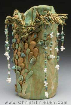 Large vessel by Christi Friesen.  Polymer and pearls, turquoise, beads over glass base.  #polymer #objetDart  #pearls  #turquoise  #artVessel  #christiFriesen