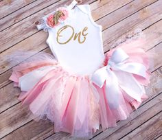THIS SET INCLUDES… ✔ Cottage Chic Style Fabric and Tulle Tutu - Comes in Pink or Request Custom Colors ✔ Super Sparkly Glitter Vinyl Transfer Bodysuit/T-Shirt (shown in Sleeveless Bodysuit, available in sleeveless, short, or long sleeve) ✔ Headband or Clip in Coordinating Fabrics with Detachable Gold Leaf Embellishment ……………………………………………………………………………………………… APPEARANCE DETAILS ☆ Tutu --- Comfortable for kids to wear and play in and adorable too, this scrappy tutu makes a great holiday outfi...