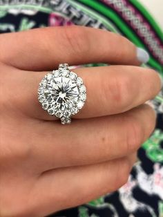 This stunning engagement ring from Christopher Designs features a large round diamond engagement ring framed by a diamond halo. #rounddiamond #diamond #halo #christopherdesigns @CrisscutNY