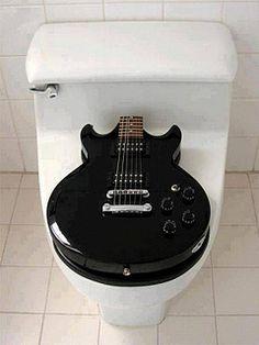 music, basement bathroom, designer handbags, rock stars, toilets, seats, electric guitars, rocks, guitar player
