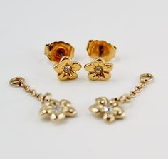 Vintage Avon Goldtone Convertible Flower Daisy Clear Glass Rhinestone Cable Chain Gold Tone Pierced Dangle Stud Earrings in Original Box NIB by ThePaisleyUnicorn on Etsy