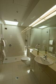 towel rack, curb-less shower, Dual drains! Accessible shower.  sink with shallow counter