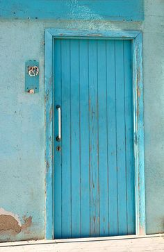 Beach Door Blue of Barcelona was taken in Barcelona, Spain near the Port area. The blue was so vibrant I had to take a photograph. I also love the stripes of the door. Enjoy!