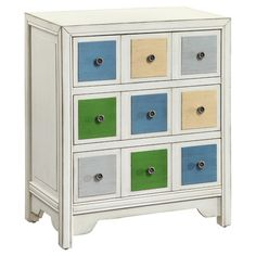 Three-drawer chest with colored panels and metal pulls.   Product: ChestConstruction Material: MDF and birch wood...