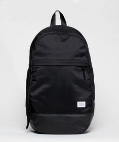 24732f9413 A minimal, water resistant backpack featuring intelligent segregation of  space and waterproof coated ballistic fabric