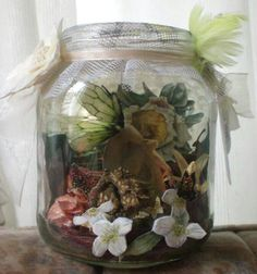 My Captured Fairy...... waiting for her release...Inside a Paper Fairy with  Foil Glass Paint 3D Wings, real Dried Seeds& Flowers as Potpourri with Autumn Scent, Paper 3D White Flowers outside, Cork Roses, Ribbon and Feathers, Tags and a Tule Closure....so the Scent can Spread!