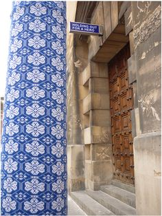 Serious yarn bombing. I thought these were Portuguese tiles.