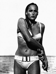 Arguably the most famous bikini of all time. Ursula Andress' iconic entrance in a white two-piece in Dr No has been voted the sexiest bikini moment ever many a time, and we can see why. Tie-top, brass buckle belt, the avant-garde sports luxe piece is credited to have boosted sales of two-pieces everywhere.