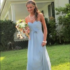 Dessy Lux Chiffon Long Dress Full length strapless lux chiffon dress with shirred bodice and matching flower detail at waist. Windsor Blue color. Dessy Dresses
