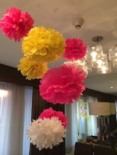 Do it yourself flower paper pompoms hanging on cealing decorations for any party.