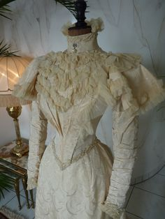 "Silk Brocade Wedding Dress, ca. 1895 //  Two piece wedding dress, ca. 1895. Label: ""J. Jay Joslin & Son, Denver, Colorado"". The dress is made of swirl patterned ivory silk. High neck bodice, capped long sleeves, ruched chiffon, pearl and crystal trims, trained skirt. Excellent condition."