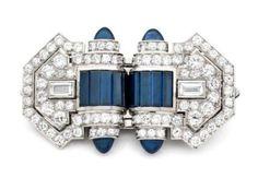 A DIAMOND, WHITE GOLD AND PLATINUM SAPPHIRE ART DECO DOUBLE CLIP