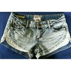 HOT KISS Denim Lace Trimmed Shorts Strut your stuff in these sexy and sweet denim shorts with white eyelet lace trim and embellished back pockets.  Please ask any questions you may have. Feel free to make an offer! Hot Kiss Shorts Jean Shorts