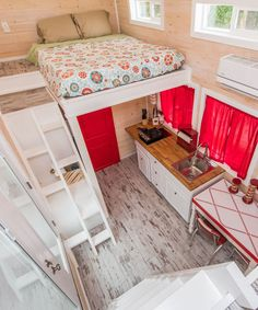 The Red Lifeguard Stand was built by Upper Valley Tiny Homes and features two queen bedroom lofts, accommodating up to four guests.
