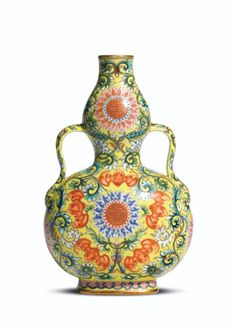 Yellow-ground famille-rose double-gourd vase, one of a pair, of Qianlong mark and period 17.7 cm., 7 in. Sotheby's Hong Kong, 9th October 2012, lot 3024.