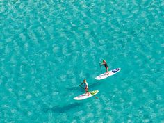 Turks and Caicos Stand-Up Paddleboarding - Turks and Caicos Vacation Rentals - Grace Bay Cottages www.gracebaycotta...
