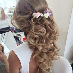 Curly Half Up, Half Down Hairstyle with Flowers