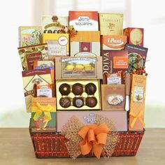 Grand Gatherings by GiftBaskets. $149.95. Make everyone feel special when they receive this basket overflowing with opulent goodies. This beautiful gift includes: English toffee, shortbread pecan cookies, cheese, olive oil crackers, wooden cheese knife, white chocolate macadamia nut cookies, Sonoma cheese straws, Elki crackers, cranberry snack mix, Ghirardelli dark and orange bar, carrot cake cookies, English tea cookies, smoked almonds, cocoa crunch bar, milk chocol...