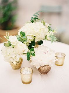 like the gold candle votives and small gold vases