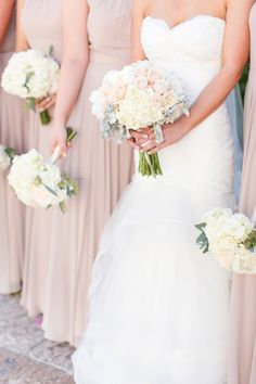 Gorgeous blushes, creams, and nuetrals for this Montelucia wedding in Scottsdale, Arizona. The florals were also a soft neutral palette and the bride wore a cathedral veil. The bridesmaids wore soft chiffon full length blush dresses.