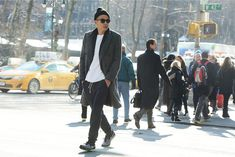 Eugene Tong, Details style director: J.Crew slim sweatpant, Louis Vuitton coat, Army Navy surplus store knit cap.