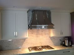 #33 014 Brushed stainless steel and polished stainless steel.  LOVE cabinets and backsplash too.