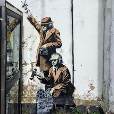 New Banksy Mural Depicts Government Agents Spying on a Phone Booth | Junkculture