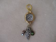 Very Unique Vintage Watch Pendant With Charms And Initial R by OldCupola on Etsy https://www.etsy.com/listing/202486026/very-unique-vintage-watch-pendant-with