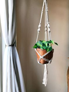 Free Shipping! The bestselling Gypsy Modern Macrame Plant Hanger is perfect for 6-8 inch pots and is made with 100% cotton three strand rope and a dark wooden ring. #macrameplanthanger #macrame