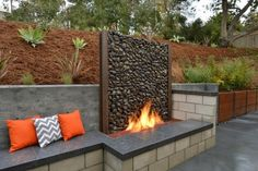 Contemporary Patio with Raised beds, Custom Gabion Retaining Wall, 7 cu. yd. Red Landscape Loose Bulk Mulch, Fire pit, Fence