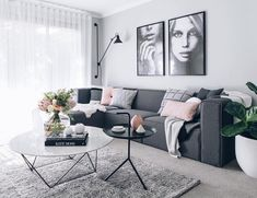 love that white coffee table and grey couch!