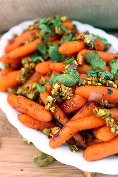 maple sage glazed carrots with toasted pistachios.
