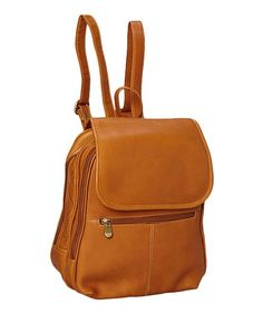 Slip on an accessory of understated elegance. This Colombian Vaquetta leather backpack stows every essential with style. Featuring a flap-over top, plenty of pockets and zipping compartments of all sizes, this handcrafted bag will soon become a favorite.