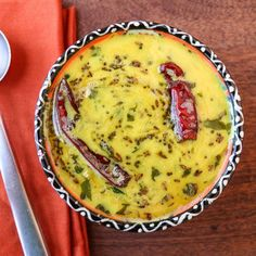 "The Punjabi Kadhi is a tangy and spicy curry that is a staple dish in North India and had along with steamed rice known as ""Kadhi Chawal"""