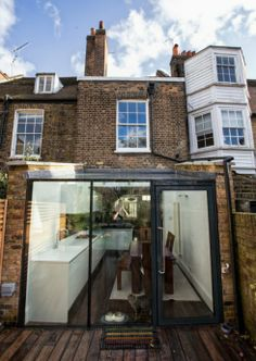A glass box extension on a listed building