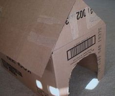 How to Make a Cardboard Doghouse.  I can think of so many ways I could use this in therapy