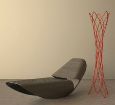 The futuristic chair near the door Cowrie red coat collection