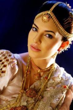 traditional Sri Lankan Bridal wear. Interesting head piece