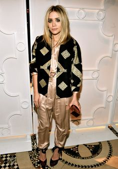 Ashley Olsen wearing: Jacket by Dries Van Noten; Top and pants by the Row; shoes by Louis Vuitton.