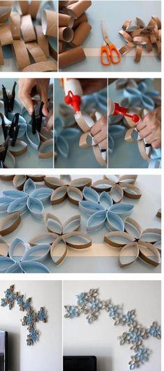 Aquesta és una imatge de Pinterest, de autor, títol, data, localització i estil desconegut. Aquesta decoració està feta a partir de rotllos de paper de wc, els quals tallats, enganxats i pintats, recreen unes flors per decorar les parets.