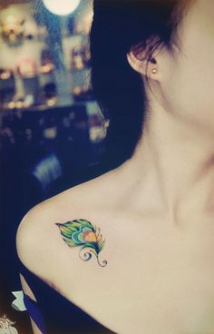 Cute, feminine small feather tattoo on front shoulder                                                                                                                                                      More