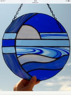 This stained glass abstract moon suncatcher is made with five diffrent shades and textures of blue glass. It measures 10 inches in diameter. Stained Glass Panels, Leaded Glass, Dichroic Glass, Stained Glass Art, Mosaic Glass, Fused Glass, Stained Glass Patterns Free, Stained Glass Projects, Moon Over Water